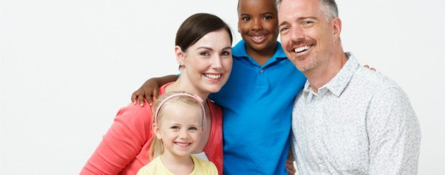 white family with adopted black little boy