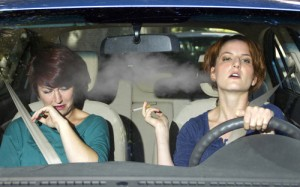 woman smoking in a car