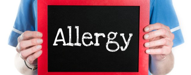 Allergy - Physician with chalkboard on isolated white background