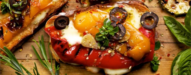 Bruschetta with grilled bell pepper, zucchini, olives and mozzarella cheese