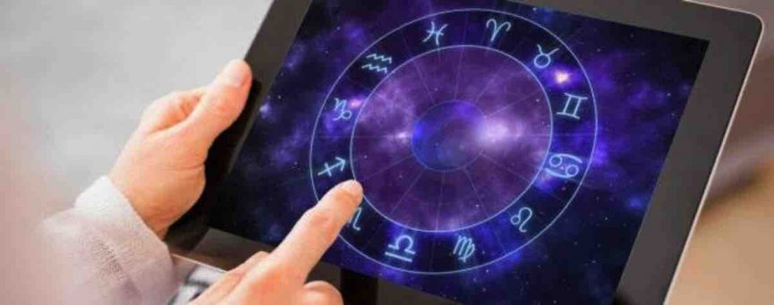 woman holding tablet with horoscope