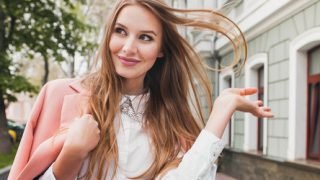 stylish woman throwing hair back