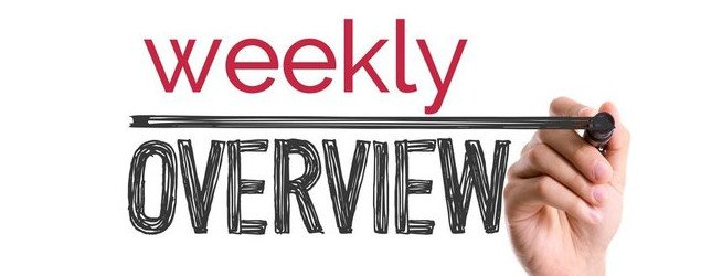 person writing weekly overview on glass