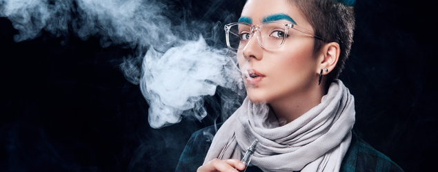 girl with blue dyed eyebrows vaping