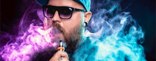 Men with beard in sunglasses vaping