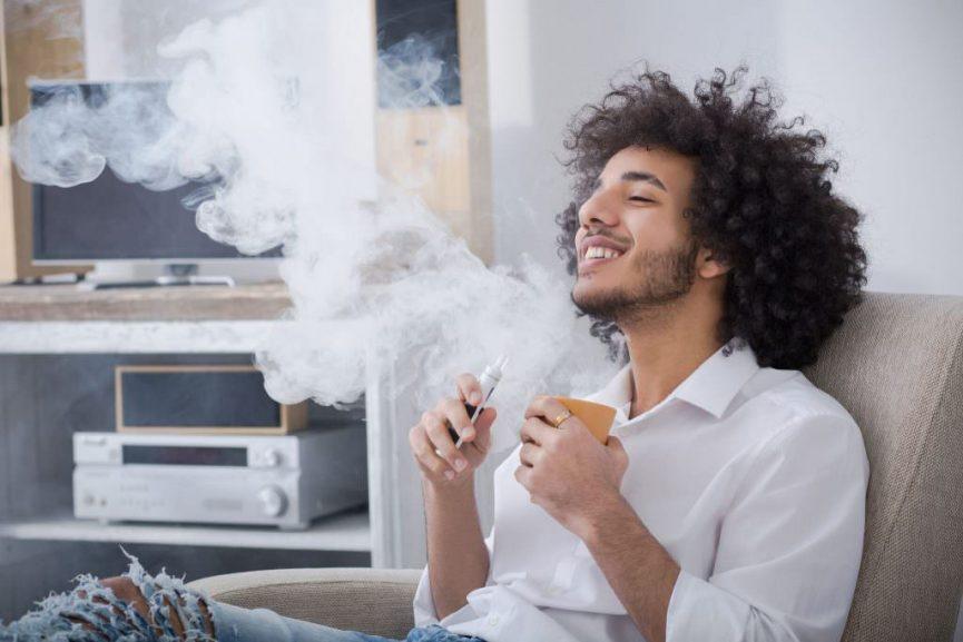 vaping mman enjoys smoke