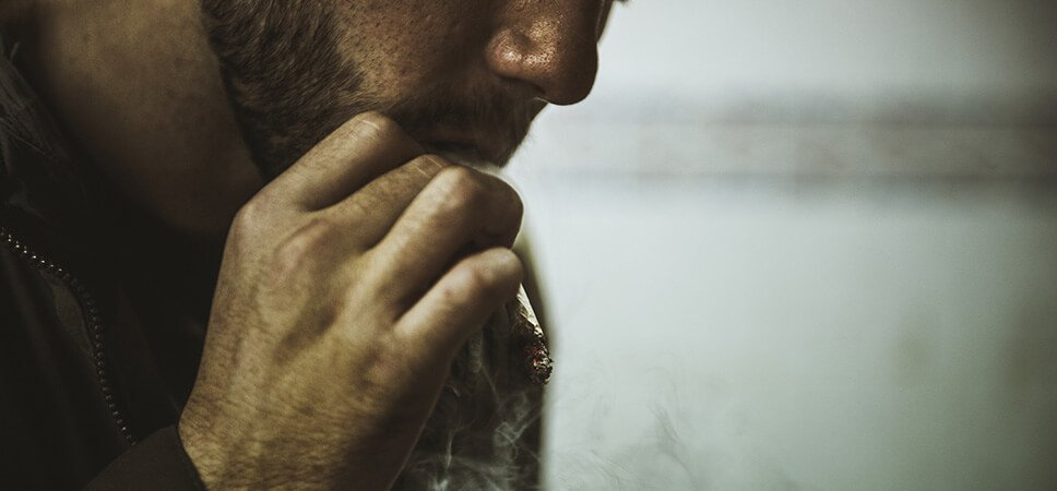 adult man smoking cigarette
