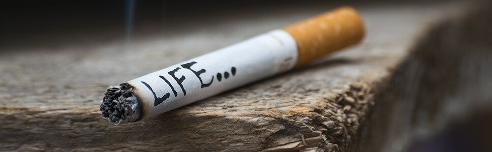 burning cigarette with written word life on it