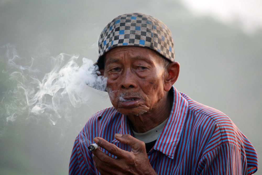 closeup of Indonesian smoking