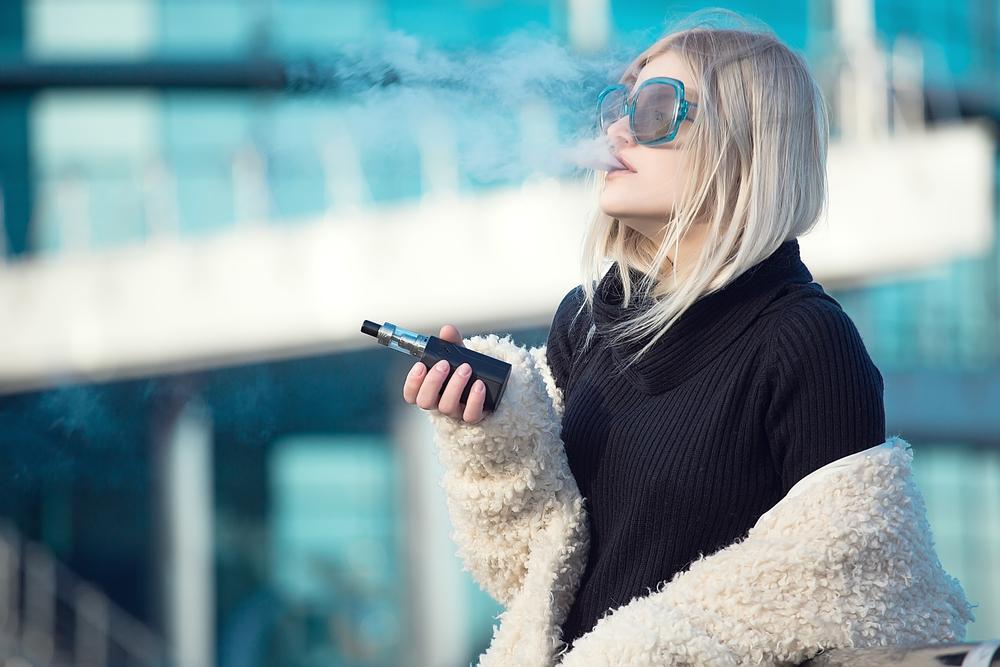 blonde vaping in the street