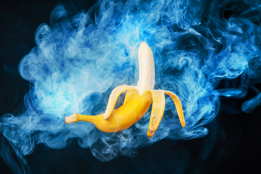 blue vapor background and banana in front