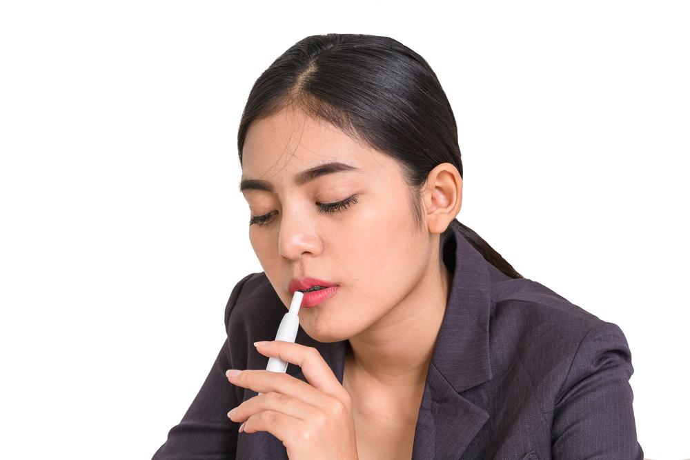 woman smoking iqos