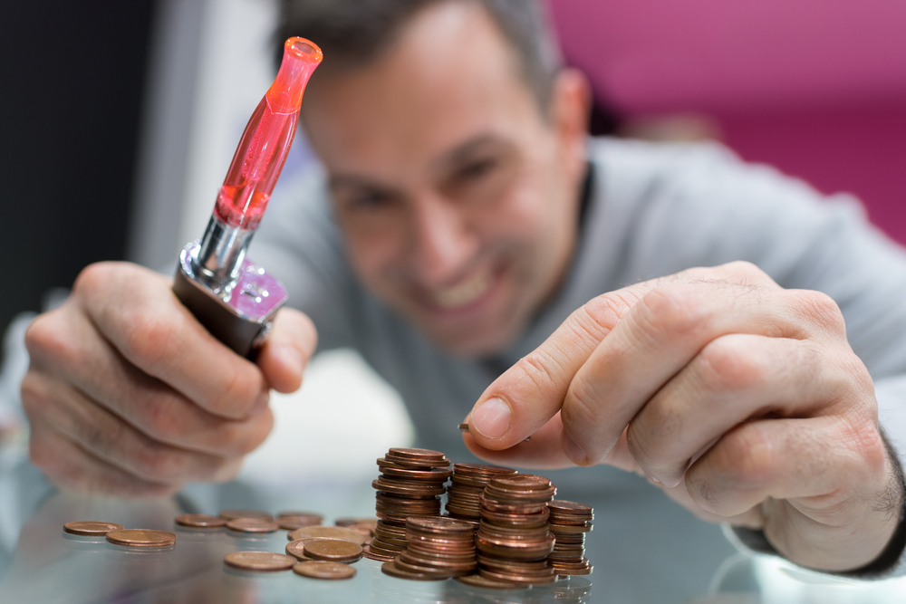 man colects coins to buy a vape device