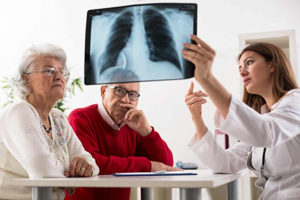 Old man with lungs problem because of smoking cigarettes image