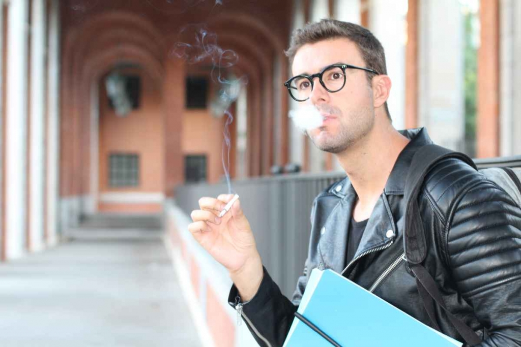 Student smoking on campus image