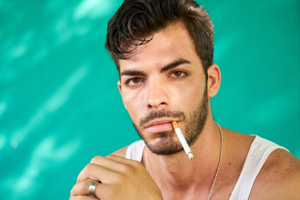 Latino smoking cigarette