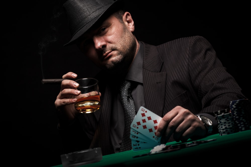 Male gambler playing poker game