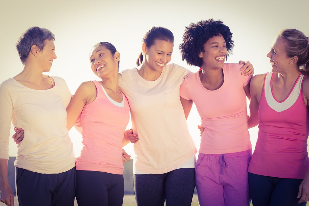 Women wearing pink together