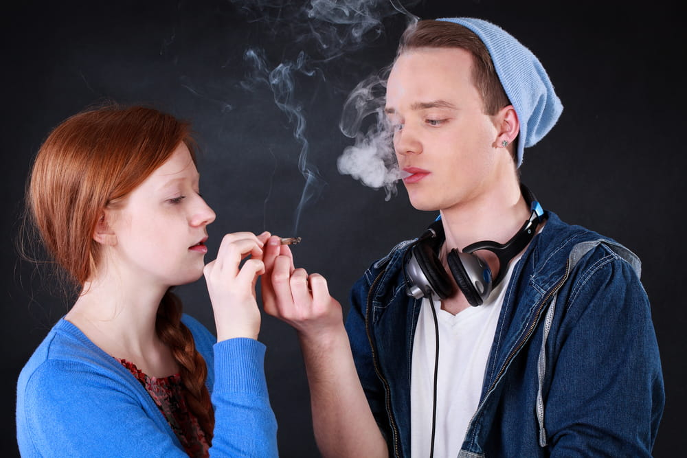 girl and boy smoking