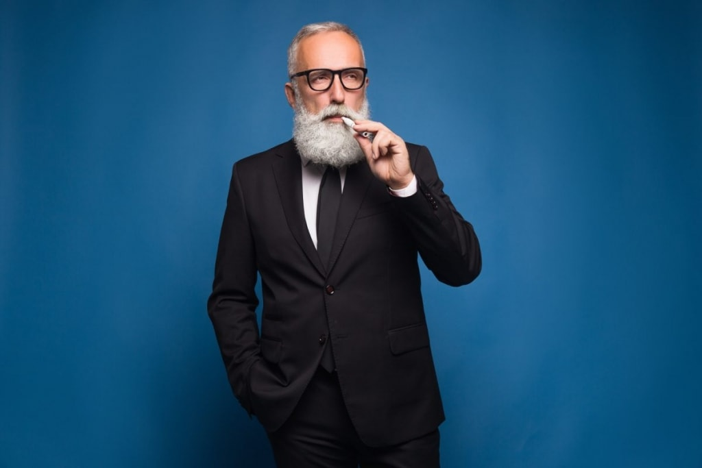 Bearded man smoking electronic cigarette image