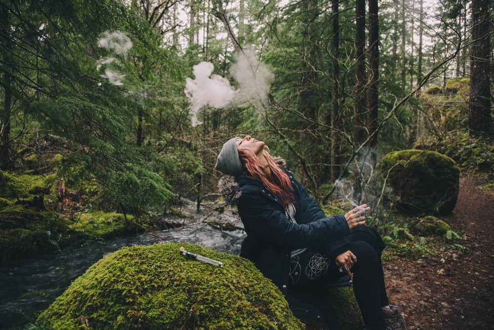 girl smokes in forest