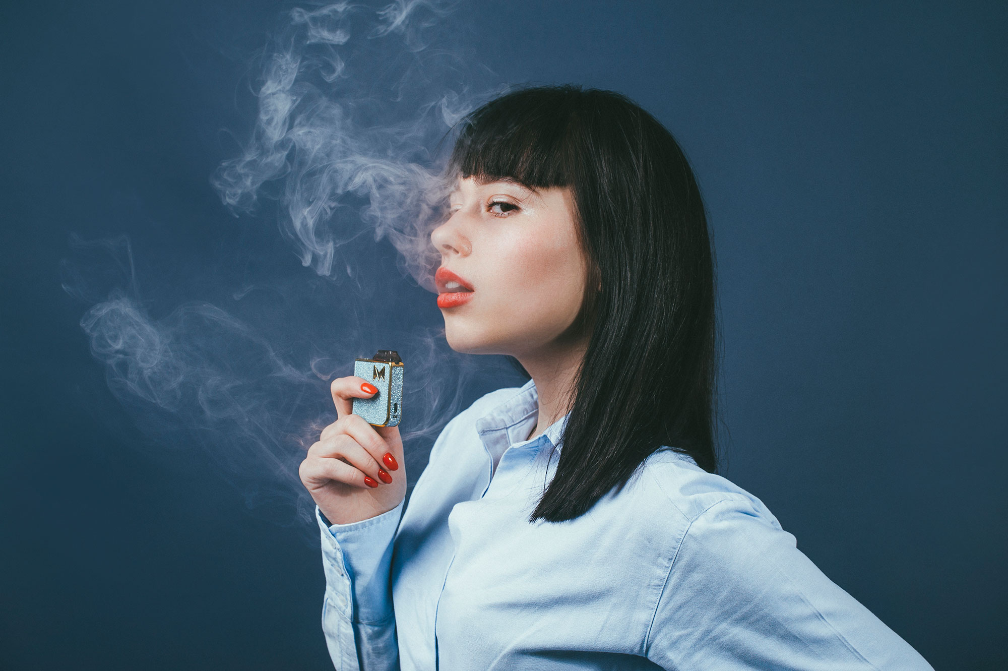 vaping half face blue girl