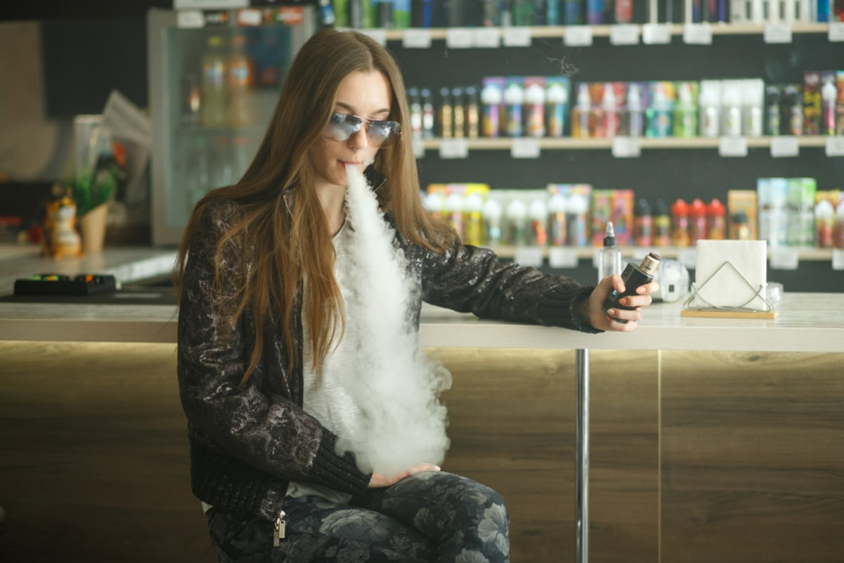 Vape teenager in vape shop