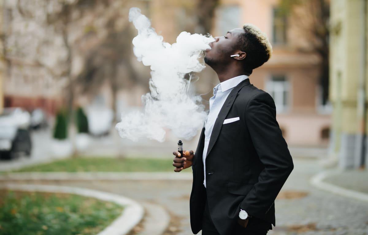 african man vaping an electronic cigarette