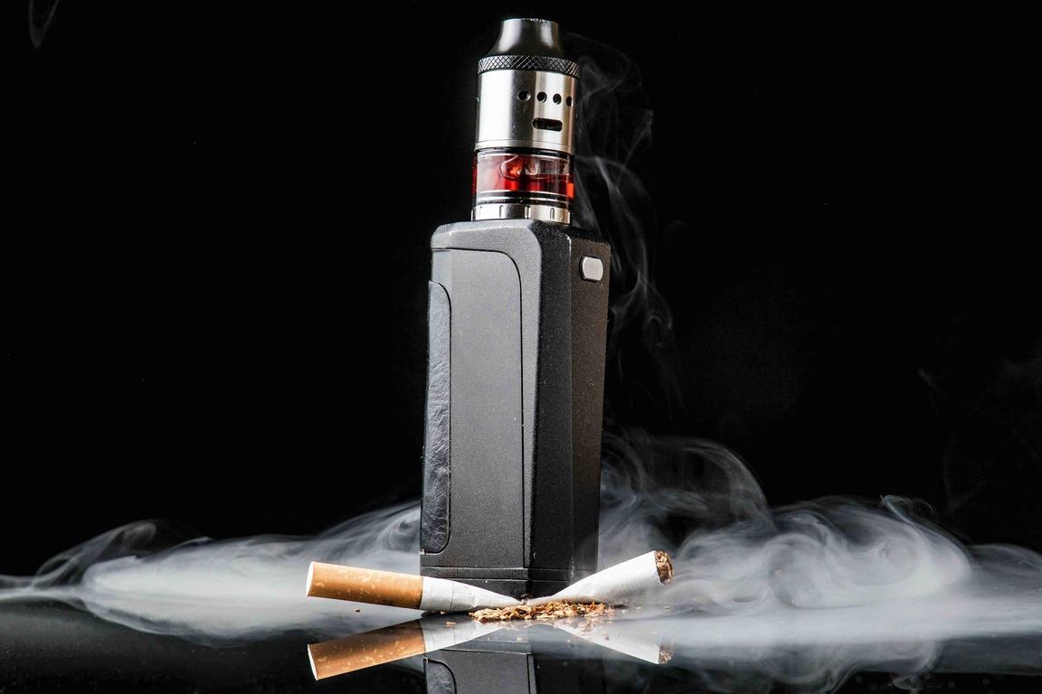 Modern Vaporiser Versus Old Tobacco Cigarette