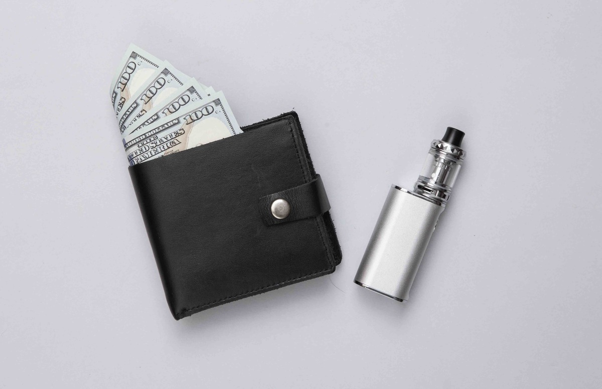Vaping device and wallet with money